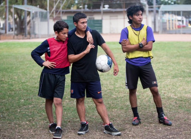 Three Oakland International High School soccer players